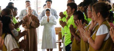 Interfaith Buddha Bathing in Canoa For United Strength